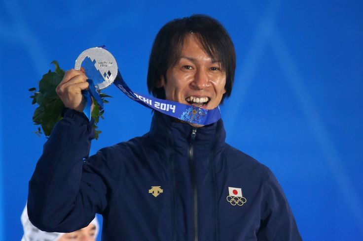 Silver medalist Noriaki Kasai of Japan celebrates on the podium during the medal ceremony for the Men's Large Hill Individual (c) Getty Images