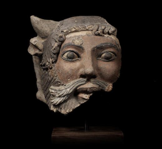 A large Etruscan polychrome terracotta head of Acheloos