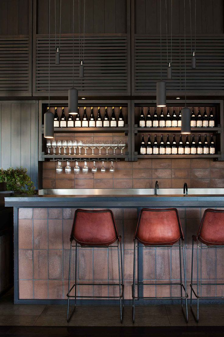 || Polperro Winery by Hecker Guthrie | Yellowtrace . Brick splashback with black japan timber joinery . Black pendant lights on pulley system