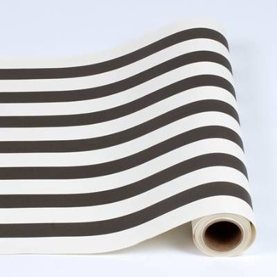 Easily add timeless elegance to tabletops with the Classic Stripe Paper Table Runner. Unpretentious yet stunning, this black and white striped runner protects surfaces from spills while accenting centerpieces and tablescapes in contemporary style. At 25 feet in length, decorate one long banquet table or several smaller tables for both casual and formal occasions.                Paper table runner in striped motif                    Protects tabletops from spills and scuffs               ...