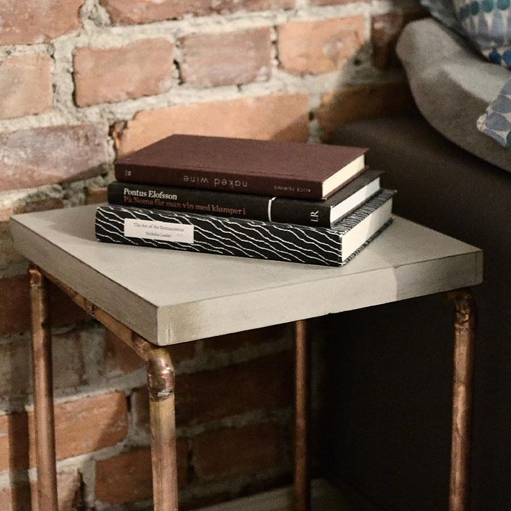 The guardian of your evening literature - our Nightstand  #jmonier #tradition #quality #handcrafted #handmade #concrete #concretetable #concretedesign #interior #interiordesign #design #norwegiandesign #norwegian #madeinoslo #oslo #copperpipe #nightstand #sthanshaugen #concretejungle #modern #modernart #moderncraft #moderndesign #local #localbrand #innovation #interiordesign #table