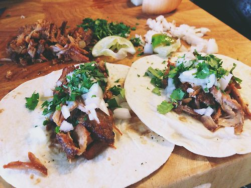 Spicy slow cooked pork loin tacos in chile de arbol/chipotle chili sauce. / fire & knives