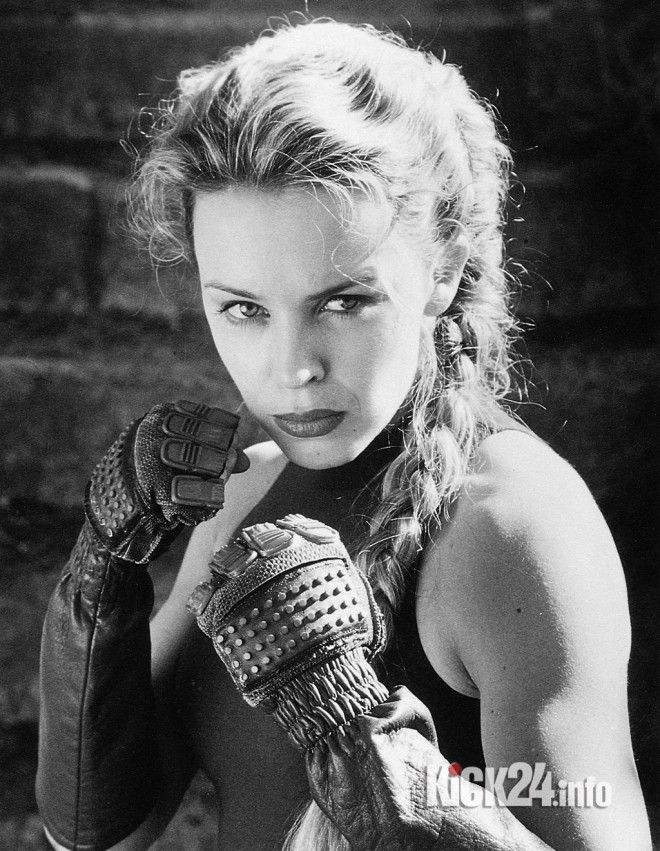 Kylie Minoque in fighting stance for movie Streetfighter with JCVD.