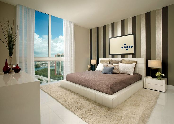 Contemporary bedroom with wonderful view of Miami skyline [Design: Zelman Style Interiors]