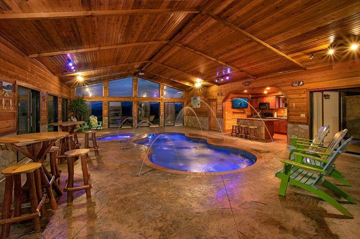 Gatlinburg, TN Mansion - incredible 6 bedroom mansion with private indoor heated pool, pool theater, outdoor covered living area, sun deck, wood burning fireplaces, full kitchen.