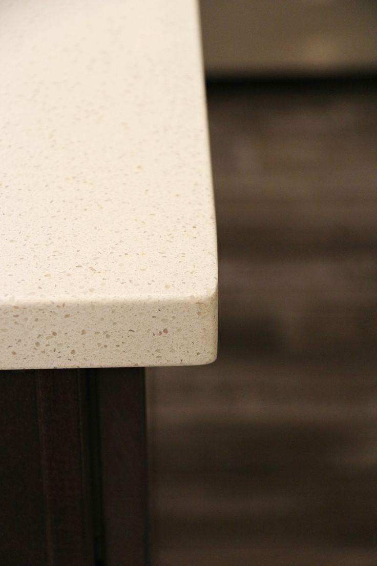 white quartz countertops and dark wood cabinets