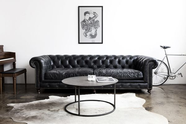 : Leather Couch, Negative Spaces, Black Leather, Interiors Design, Coff Tables, Cowhide Rugs, Living Rooms Rugs, Black White, Chesterfield Sofas