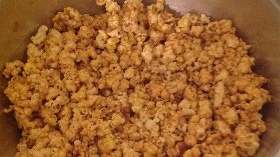 Popcorn is sweetened with corn syrup, honey, sugar, peanut butter, and vanilla in this recipe.