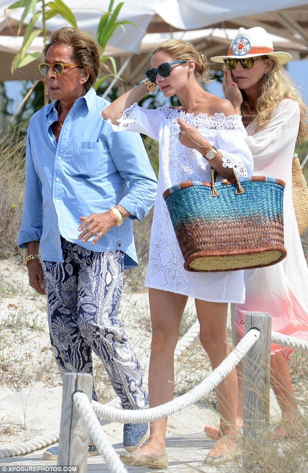 Fashion friends: Designer Valentino Garavani (left) joined Olivia Palermo (centre) for a visit to Formentera on Thursday as they spend a week on his luxury yacht - July 30, 2015