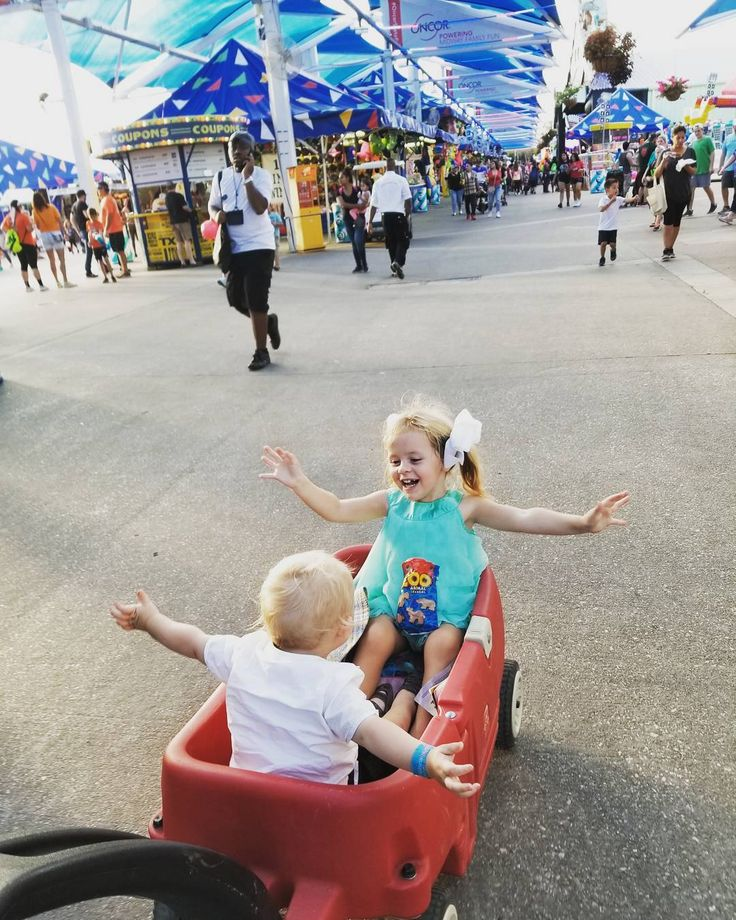 Having so much fun at the Texas State Fair #sftmidway #oncorstatefair #bigtex #bigtexas #texas #texasstatefair #statefair #dallas #kids #enfants #toddlers #babies #bebes #siblings #family #fun #fair #tx #dallastx #wagon #littletikes #flying #midway #usa #americanlife #1yearold #3yearsold #brotherandsister #frereetsoeur #swissintheusa