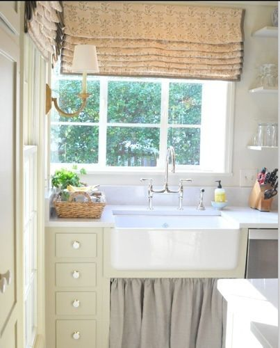 linen curtain to hide stuff under cabinet.