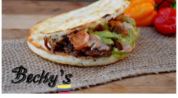 Arepa Becky's  Beef, fresh colombian bacon,mozzarella cheese, guacamole,golf sauce