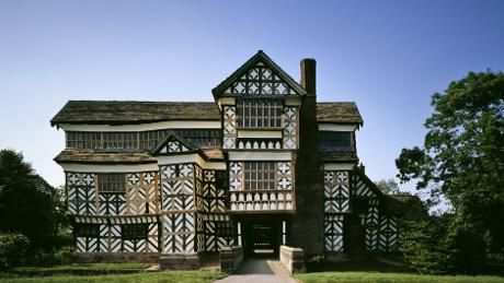 The south front of Little Moreton Hall showing the half-timbered construction, small window panes and long gallery
