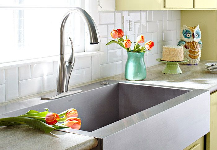 This Kohler top-mount, apron-front sink is perfect for remodels -- it requires only a rough cut to existing standard cabinetry, and can be paired with most countertop materials. Top it off with a Delta high-arc faucet featuring a hidden pull-down sprayer.