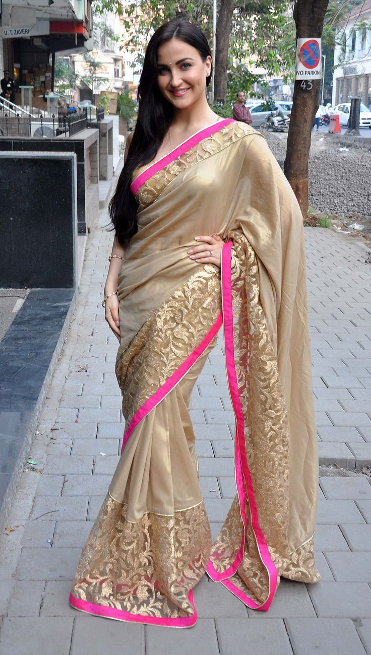 golden saree with pink border https://www.facebook.com/nikhaarfashions