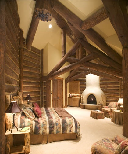 Bedroom in wood home. New Mexican style log cabin?