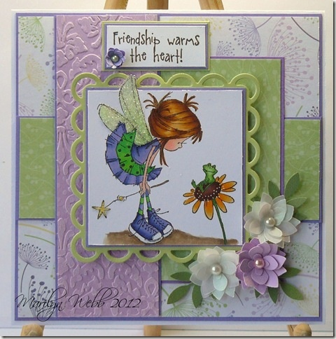 Frog On Flower stamp by Nellie Snellen.