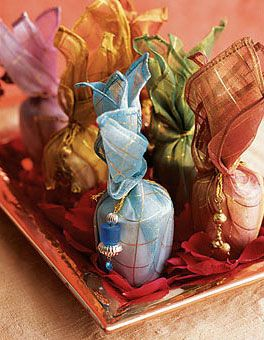 scented votives wrapped in organza and tied with beaded cord