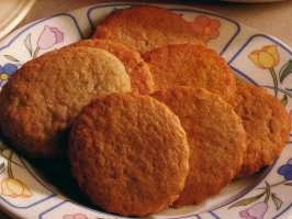 Soetkoekies (Spicy biscuits with almonds and Port) are of Dutch origin and have been a favorite South African treat for many years, together with other traditional cookies such as crunchies and rusks. The Dutch colonised Cape Town in 1652 and rapidly established their cooking traditions at the Cape, so this is probably one of the older recipes still in use in South Africa.