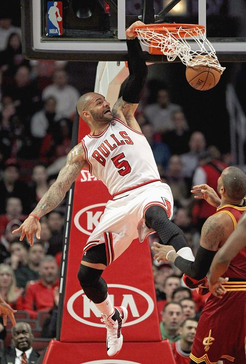 Carlos Boozer slames home a dunk during Tuesday's...