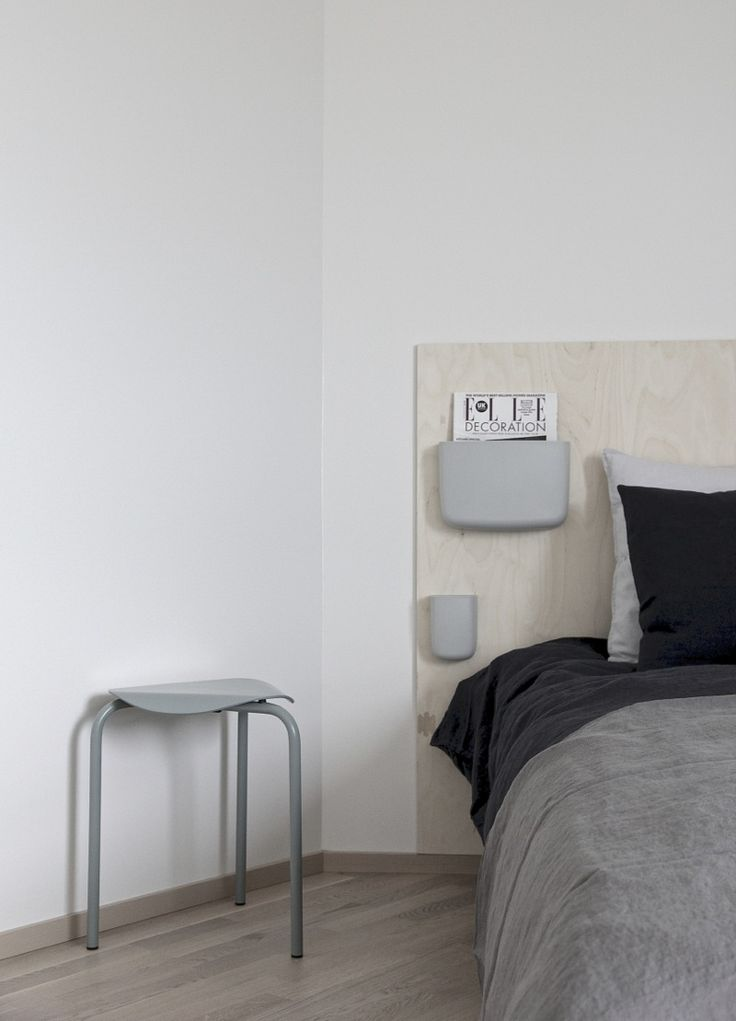 Simple diy headboard: Normann Copenhagen´s Pockets + plywood board.