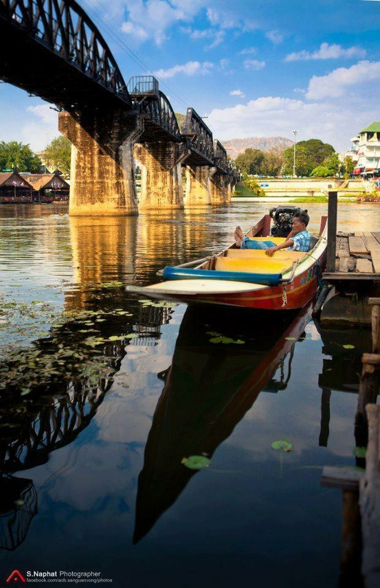 Go to the River Kwai Bridge, while you are in Kanchanaburi!