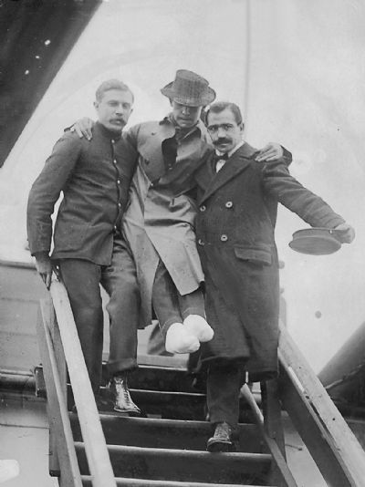 Carried ashore in New York with feet crushed and frostbitten Mr Harold Bride, second wireless operator of the Titanic, leaving the RMS Carpathia. (Topham/Topham Picturepoint/PA Images)