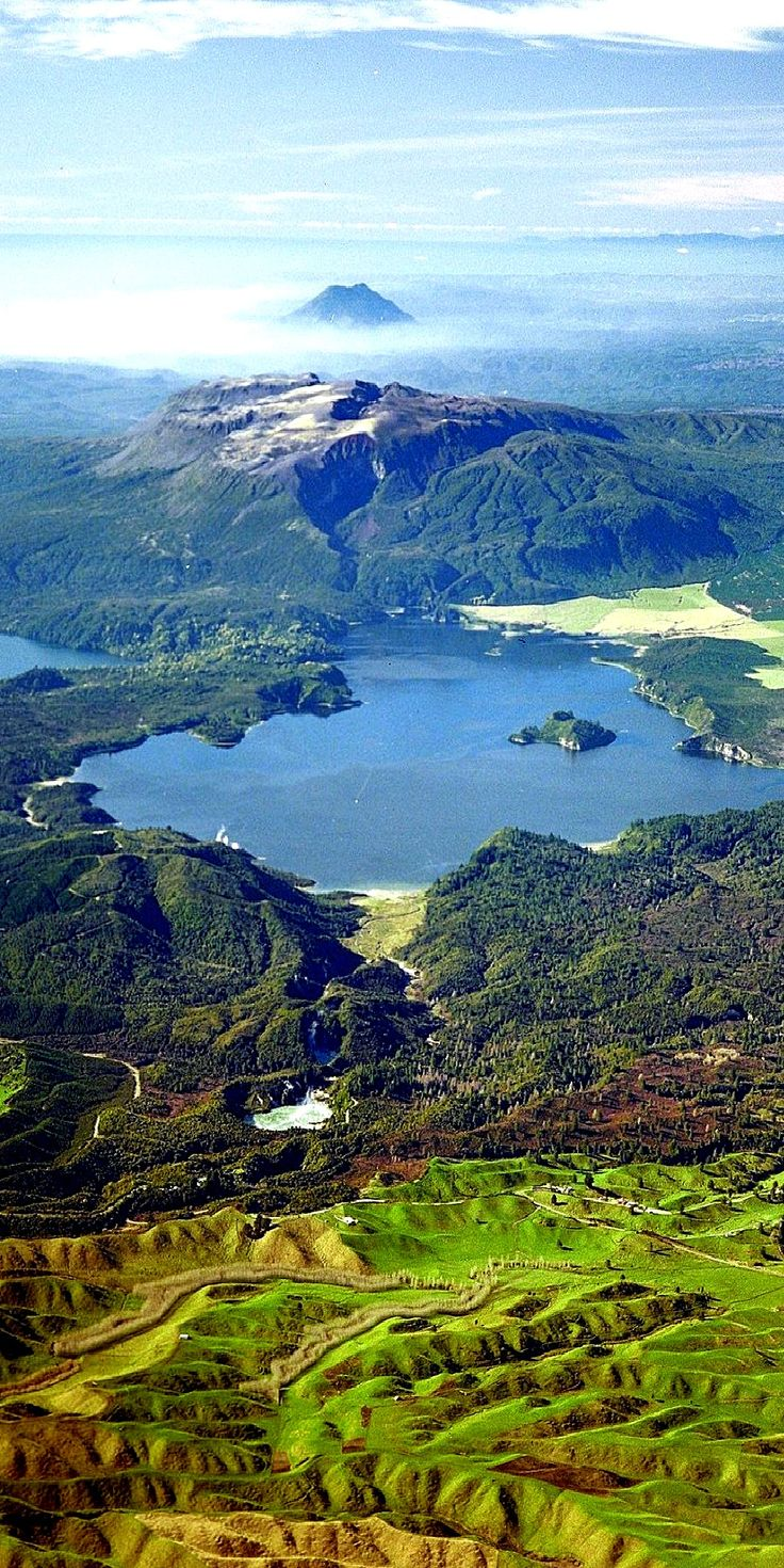 """Bill✔️ . """"Wonderful Waimangu is the largest geothermal park in New Zealand"""" it is low centre of this image. The Wonderful lake, mid-photo is Blue Lake, and to its left, equally famous Green Lake, the site of the """"Buried Village"""", which was smothered in volcanic ash, burying a small Maori village, Te Wairoa. Mount Tawarewa exploded in 1886, killing 120 people in that village. Immediately behind the Green Lake, and in the image the mountain with no top and no vegetation, is Mt Tawarewa. Bill…"""
