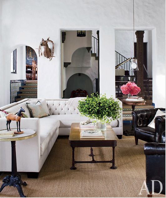 Sheryl Crow has a tufted sectional, as seen in Architectural Digest. Again, the exposed wood feet gives the sectional more modern and clean lines.