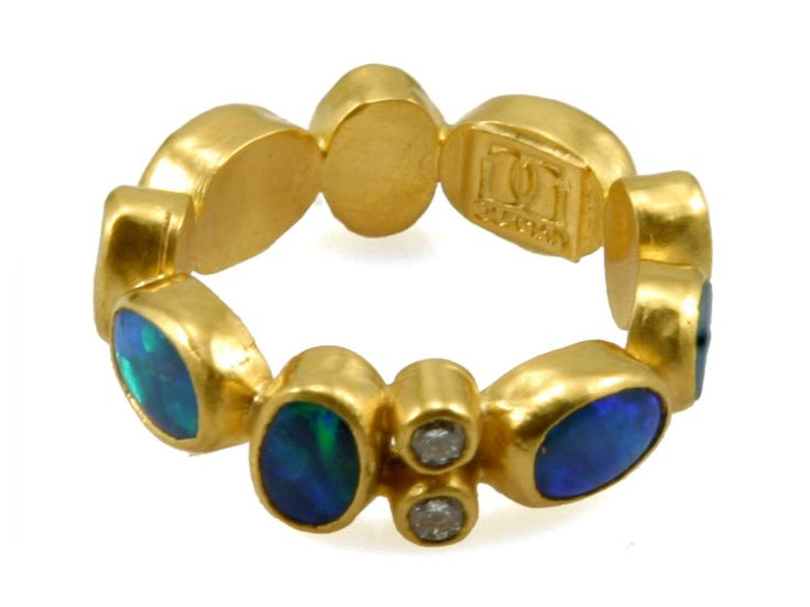 Collection : Amulet Style # : MR-OPDI Description : Opal Paradiso stacking ring in 24K gold featuring multiple Australian opals and a pair of white diamond accents. Stone : Opal Palette : Blue Group : Classic Line : 24K Pure Gold Size : 6.5[...]More...