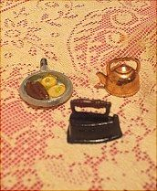 Skillet with eggs, tea pot and iron.  All sold together in KITCHEN MINIATURES on website http://barbspencerdolls.com