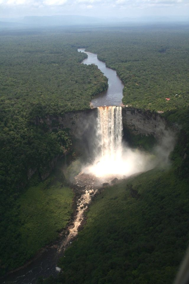 Kaieteur Falls in Guyana ~ One of the most powerful waterfalls in the world, Kaieteur Falls in central Guyana is a must-see for those who want to witness a true wonder of the world. It's said that you can hear the thunderous sound of the falls long before you get a glimpse of them. Watch as 30,000 gallons of water per second shoot out over a 820 foot cliff into the middle of a misty jungle. For daredevils