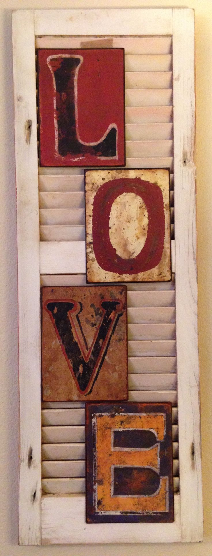 """Love the Lord your God with all your heart and with all your soul and with all your mind."" Matt 22:37 An old shutter from our previous home cleaned up rustic. The rusty looking letters hung nicely on the slats."
