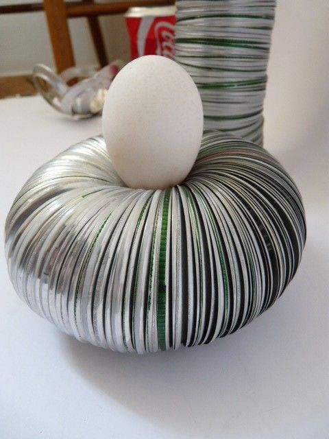 Egg cup recycled from aluminium Cans by Ivča Vostrovska.