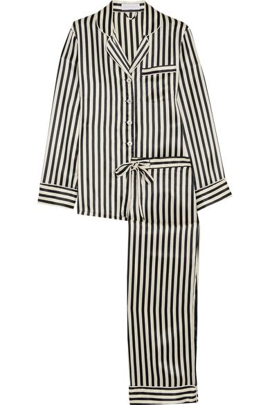 Inspired by styles worn by Coco Chanel, Olivia von Halle's 'Lila' pajama set is crafted from smooth silk-satin with black and champagne stripes. The top is finished with lustrous mother-of-pearl buttons, while the pants have a flexible drawstring waist. Tuck the shirt in and add a pair of sharp heels to elevate yours for evenings out.