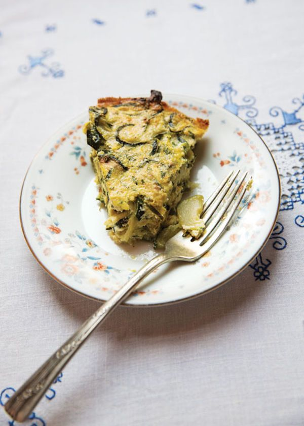 A savory summer pie with a base of fresh ricotta and eggs seasoned with shallots, garlic, and pecorino is the answer to an overly abundant vegetable crop.