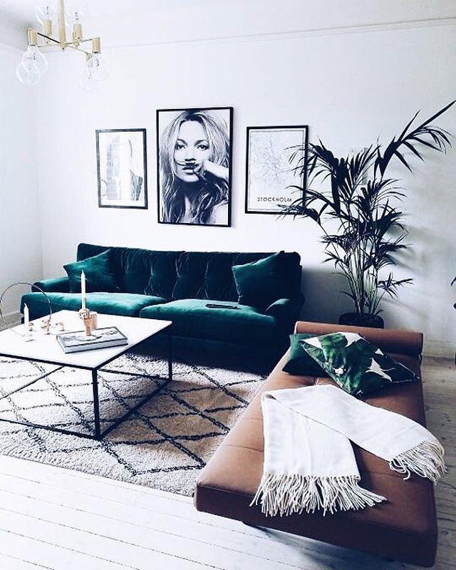 Emerald green velvet sofa, Berber rug, day bed, Kate Moss print