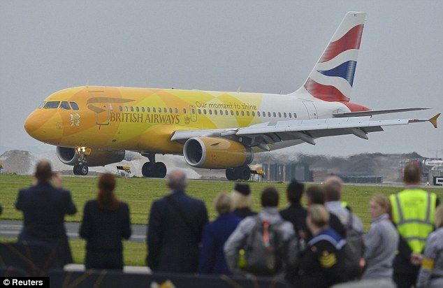 Arrival: A British Airways jet carrying the Olympic flame lands at RNAS Culdrose base near Helston in Cornwall