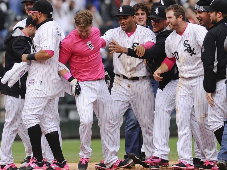 CELEBRATE GOOD TIMES: Baseball's Walk-Off Wins - May 10 -  White Sox's Gordon Beckham, center, has his jersey removed by teammate Micah Johnson as they celebrate after Beckham hit a game-winning single in the ninth inning.  -    © Matt Marton, AP