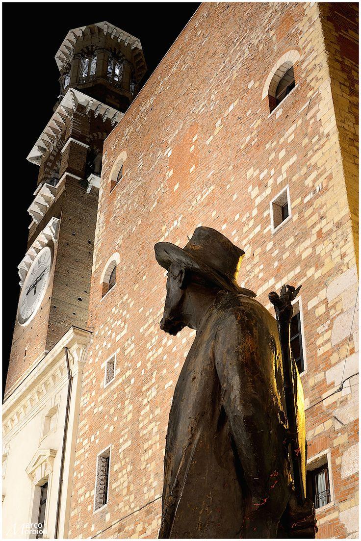 Verona, Piazza delle Erbe with the poet Berto Barbarani watching the Lamberti Tower