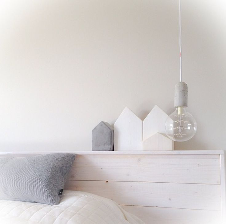 Love this single bulb as bedside light