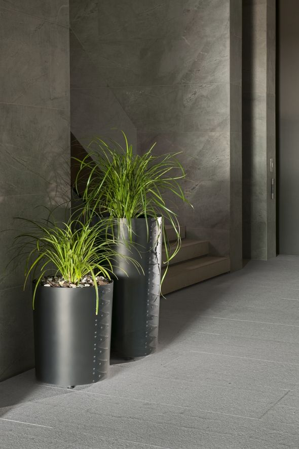 Designed by Gregor Jenkin, the Hancock planter is formed from heavy gauge, hot-rolled steel. The true character of this pared-down planter with its meticulously crafted detail is realised over time, as the steel weathers when exposed to the elements to reveal simple patterning.  Hancock Sizes  Small: Height 600mm Large: Height 975mm