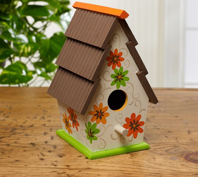 Bright daisies decorate this sweetly shingled birdhouse. Make this craft using FolkArt paints. The wooden birdhouse can be found at your local Walmart.