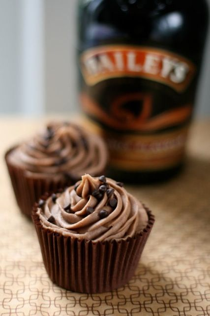 Baileys Cupcakes with Baileys butter cream:  hmm....since i am obsessed with cake-pops, i wondered how these would be on sticks ;)