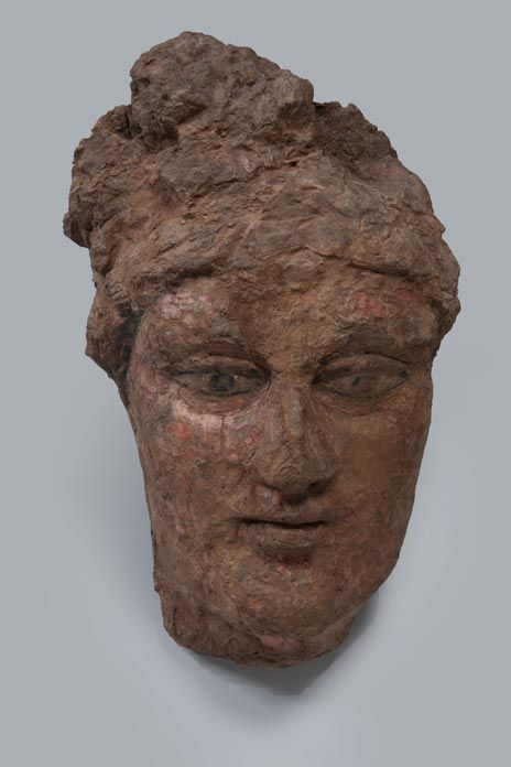 Head of a Youth or Girl (known as 'Red Head') Chorasmia, Toprak-Kala, 3rd–4th century Clay, pressed in a mould and painted © State Hermitage Museum, St Petersburg