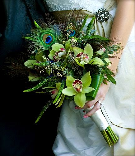 Orchid and peacock feather bouquet. Images by Jeff Tisman Photography, arrangement by Monday Morning Weddings