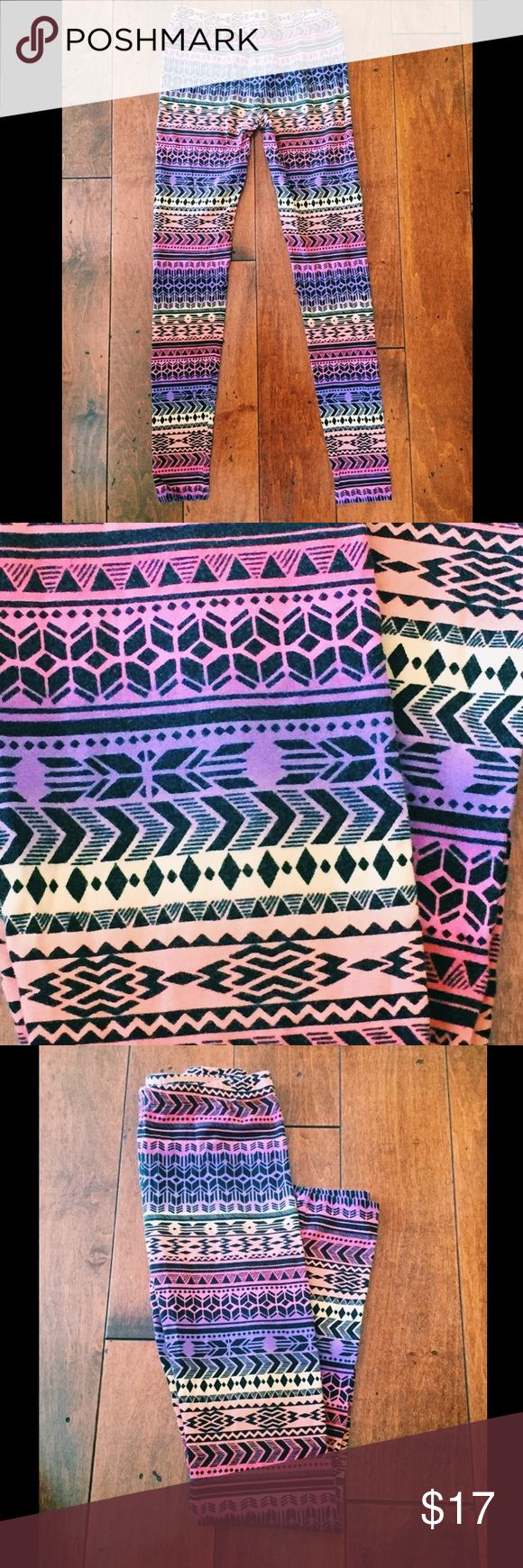 Forever 21 Colorful Aztec Print Leggings Forever 21 Colorful Aztec Print Leggings: Multicolored leggings with Aztec print design, gently worn, like new, light weight material, tue to size fit, made from 95% Cotton, 5% Elastic, elastic waistband and knit. Forever 21 Pants Leggings