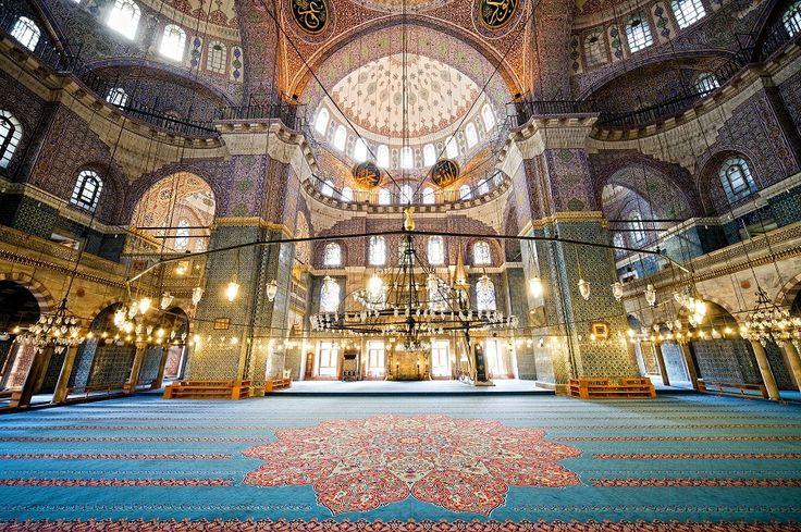 Inside the historic Sultan Ahmed Mosque, Built between 1609 - 1616 to reassert Ottoman power. Often known as the Blue Mosque for the blue tiles adorning the walls of its interior.  It is still popularly used as a mosque.