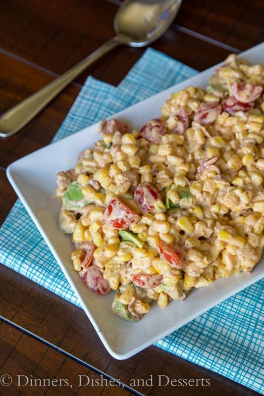 Southwestern Corn Salad - Corn with bacon, avocado, and tomatoes in a creamy Southwestern style dressing
