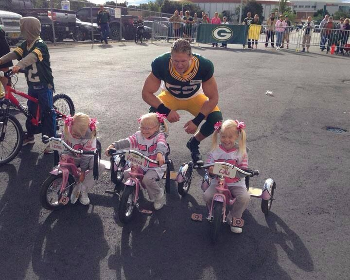 @Bianca Sebecke Duke Bobber: Their bikes were too small, so Clay just stopped to say hello to these triplets in 52 jerseys. From: Green Bay Packers twitter page